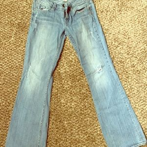 Silver size 30 distressed jean with flare bottom